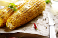 Kitchen table with grilled sweet corn cob under melting butter a - PhotoDune Item for Sale