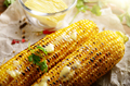 Grilled sweet corn cob with melting butter and greens on baking - PhotoDune Item for Sale