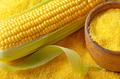 Ripe fresh organic sweet corncob and wooden bowl closeup on grit - PhotoDune Item for Sale
