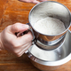 sifting the wheat flour through sifter into bowl - PhotoDune Item for Sale