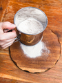 sifting the flour through sifter on wooden board - PhotoDune Item for Sale