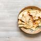 Naan flat bread baked in tandoor on brass plate - PhotoDune Item for Sale