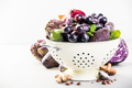 Purple fruits and vegetables in colander - space for text - PhotoDune Item for Sale