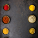 Various bowls of spices over dark background - PhotoDune Item for Sale