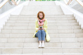 Woman sitting on the stairs and using her smartphone - PhotoDune Item for Sale