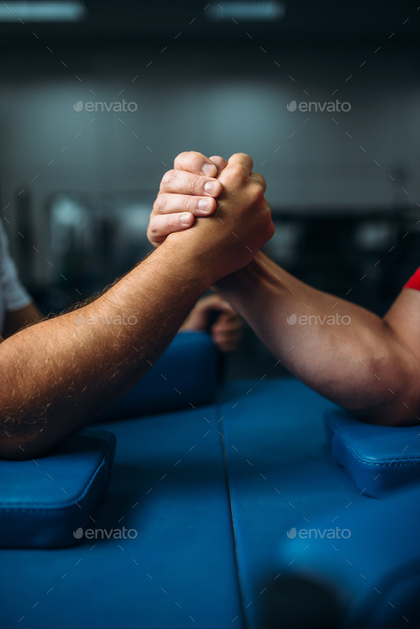 Joined male hands at the table, wrestling concept - Stock Photo - Images