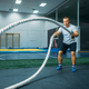 Male athlete with ropes in gym, crossfit workout - PhotoDune Item for Sale