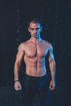Fresh portrait of muscular man with water splashes on dark background. - PhotoDune Item for Sale