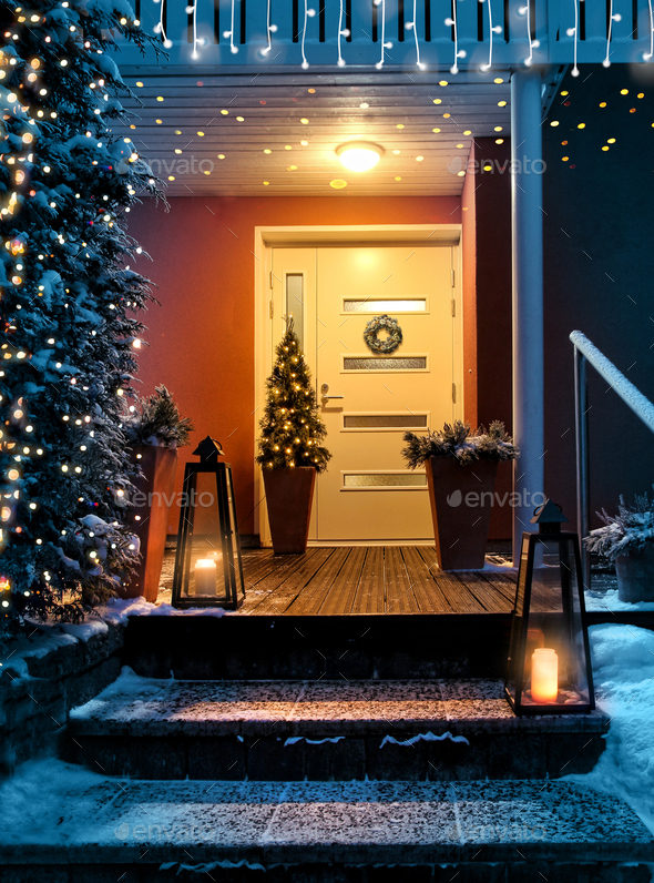 Welcome Christmas house entrance door in Xmas evening - Stock Photo - Images