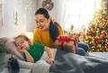mom preparing Cristmas gift to daughter - PhotoDune Item for Sale