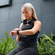 Woman Checks Workout Performance On Smart Watch in City - PhotoDune Item for Sale