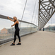 Woman Checking Heart Rate Using Smartwatch After Workout On Bridge - PhotoDune Item for Sale