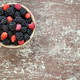 Small clay bowl of freshly assorted berries - PhotoDune Item for Sale