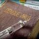 Syringe on an old book on dengue virus, conceptual image - PhotoDune Item for Sale