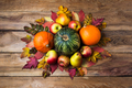 Thanksgiving centerpiece with orange and green pumpkins - PhotoDune Item for Sale