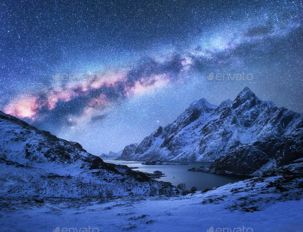 Bright Milky Way over snow covered mountains and sea bay at nigh - Stock Photo - Images