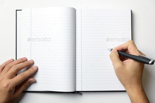 Empty note book with man hands hold a pen - Stock Photo - Images