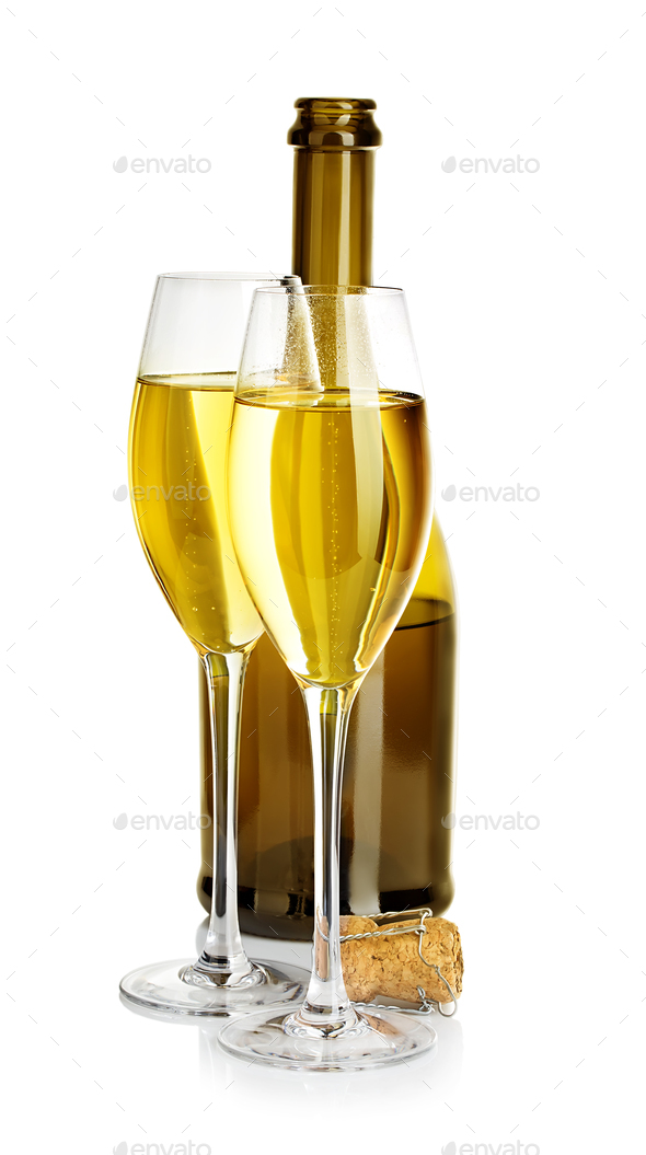 Two glasses of champagne on the background of brown bottles close-up isolated on a white. - Stock Photo - Images