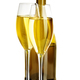 Two glasses of champagne on the background of brown bottles close-up isolated on a white. - PhotoDune Item for Sale