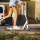 Free Download Beautiful girl riding a scooter down the street Nulled