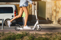 Beautiful girl riding a scooter down the street - PhotoDune Item for Sale