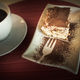 Free Download Slice of Tiramisu Cake and a cup of black coffee Nulled