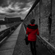Free Download Woman wearing red jacket visits remains of Berlin Wall Nulled