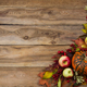 Free Download Rustic fall background with pumpkin, apples, viburnum Nulled