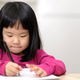 Young little Asian girl learning to write - PhotoDune Item for Sale