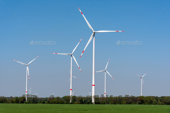 Wind turbines in an agricultural area - Stock Photo - Images