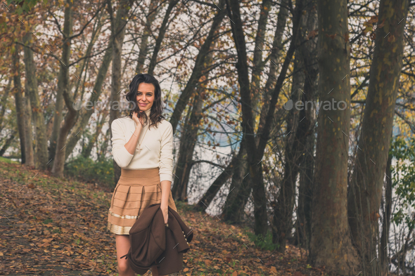 Beautiful young woman posing in a city park - Stock Photo - Images