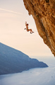 Female rock climber falling of cliff while lead climbing - PhotoDune Item for Sale