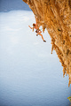 Young female rock climber in bikini hanging with one hand  - PhotoDune Item for Sale