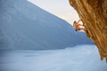 Young female rock climber on challenging route on cliff - PhotoDune Item for Sale