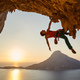 Male rock climber hanging with one hand on challenging route  - PhotoDune Item for Sale