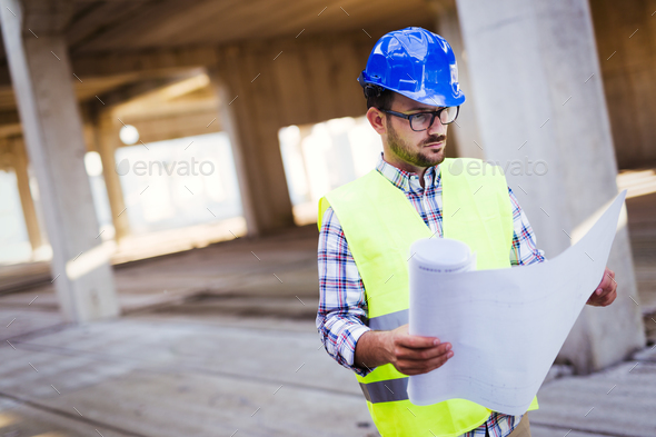 Young handsome business man construction site engineer - Stock Photo - Images