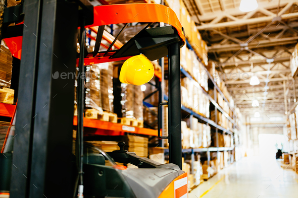 Picture of forklift machine parked in warehouse - Stock Photo - Images