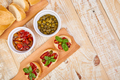 Bruschetta or crostini with sun dried tomatoes and capers - PhotoDune Item for Sale