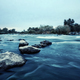 Stones in the water on shallow mountain river. - PhotoDune Item for Sale