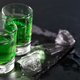 Two glasses of absinthe and melted ice cubes - PhotoDune Item for Sale