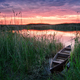 Wooden boat on the lake at sunset - PhotoDune Item for Sale