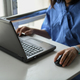 Sick woman using laptop to work on table. - PhotoDune Item for Sale