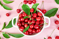 Red cherry in white bowl on pink background. - PhotoDune Item for Sale