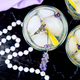 Lavender lemonade with lemon and ice on black background - PhotoDune Item for Sale