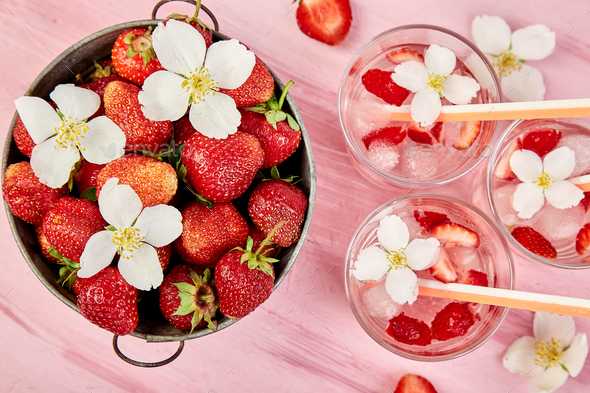 Strawberry detox water with jasmine flower. Summer iced drink or tea - Stock Photo - Images