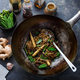 Chineese noodles stir-fry preparation in a wok, close view - PhotoDune Item for Sale
