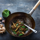 Beef, vegetables and noodles stir-fry in a wok, copy space - PhotoDune Item for Sale