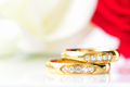 Close up Red roses and gold rings on white_-13 - PhotoDune Item for Sale