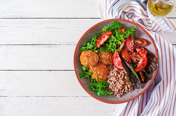 Meatballs, salad of tomatoes and buckwheat porridge on white wooden table.  - Stock Photo - Images