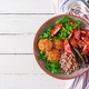 Meatballs, salad of tomatoes and buckwheat porridge on white wooden table.  - PhotoDune Item for Sale